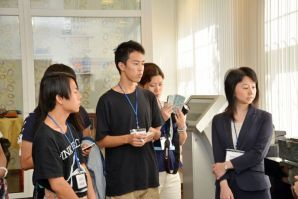 Japanese delegates study the customs of the Russian culture